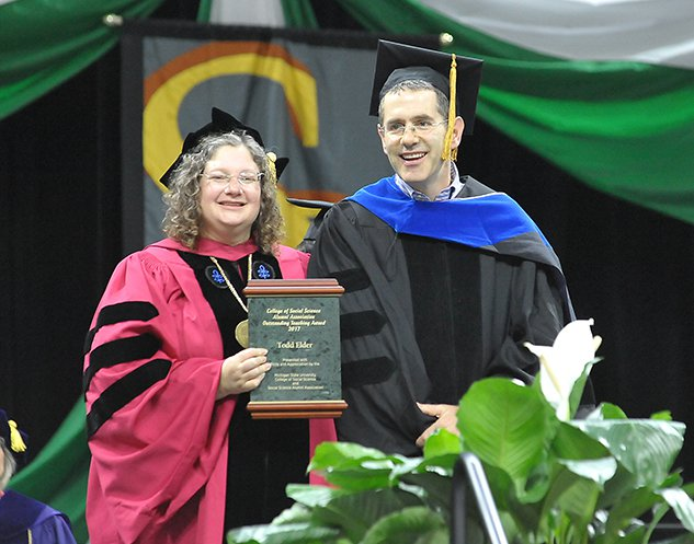 Dean Croson presenting the award to Professor Elder