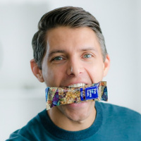 Ryan Devlin, with a This Bar Saves Lives nutrition bar displayed in his mouth